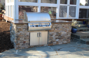 grill island with granite countertop